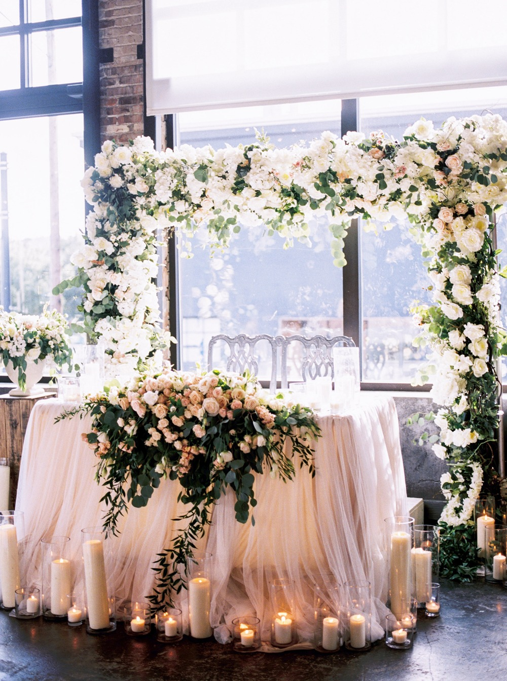 Flower covered sweetheart table