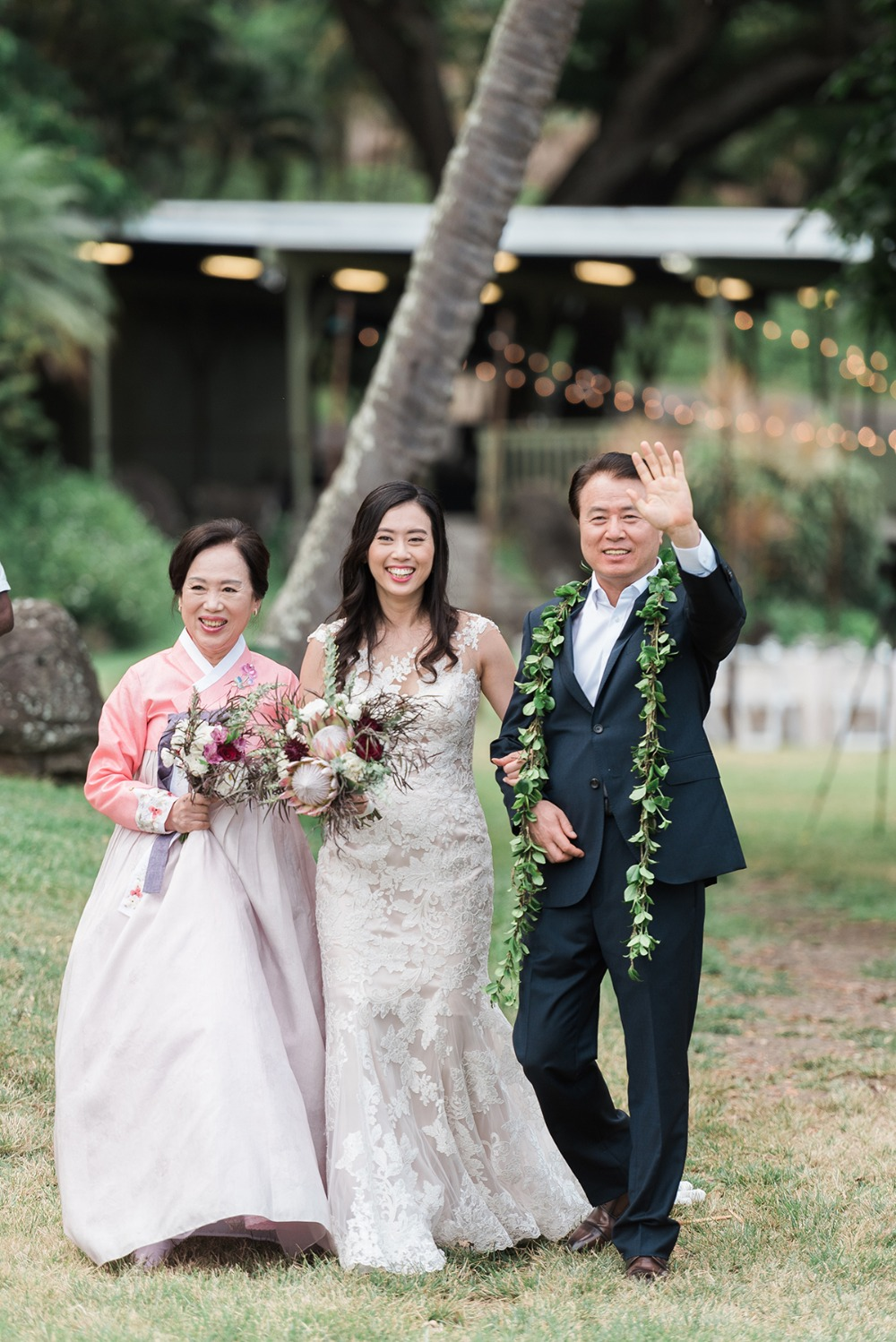 bride being walked down the aisle by mother and father