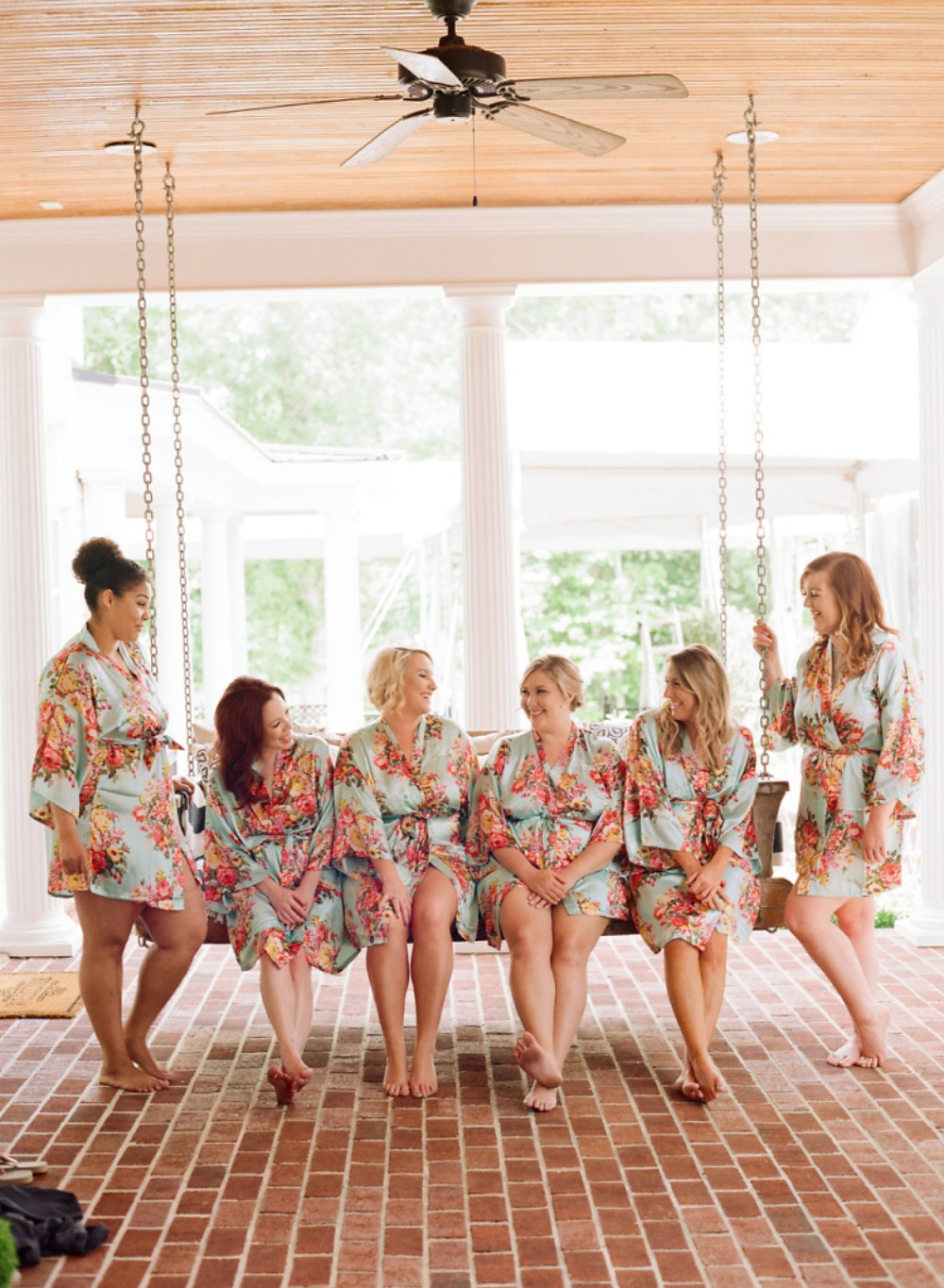 bridal party on the porch swing