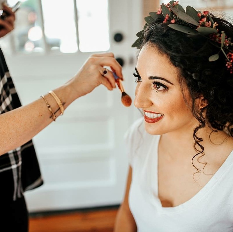 bride-getting-makeup-done-by-femme-akoi-studio