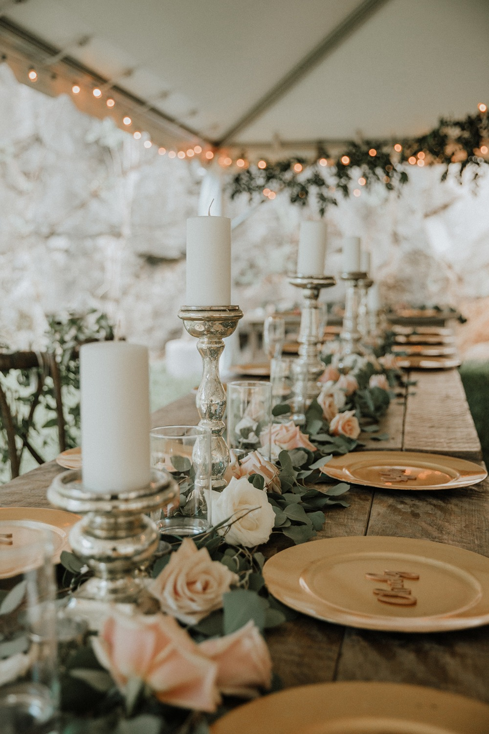 rose and eucalyptus garland centerpiece with pillar candles