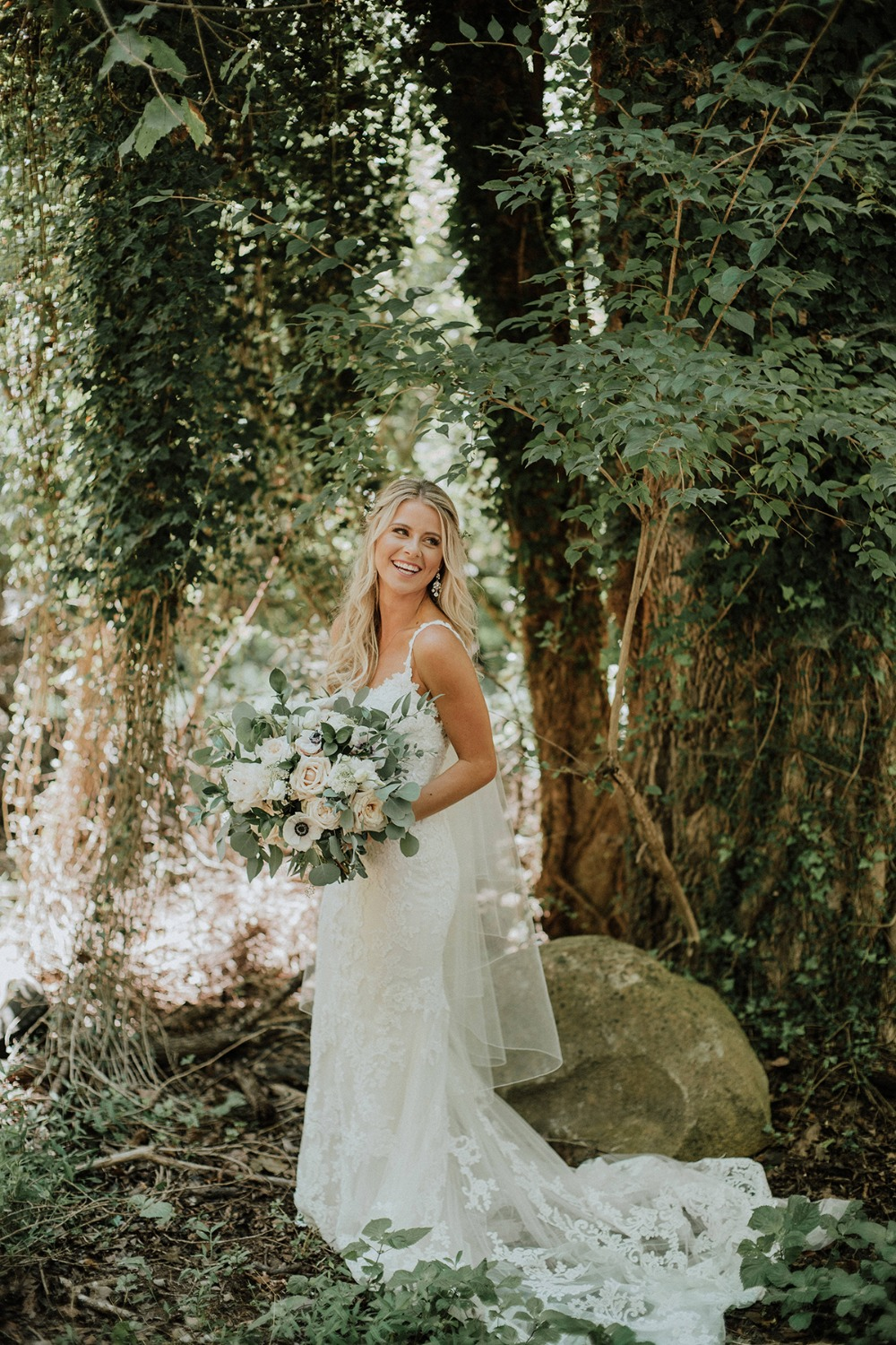 bride in fit and flair lace gown from Posh Bridal
