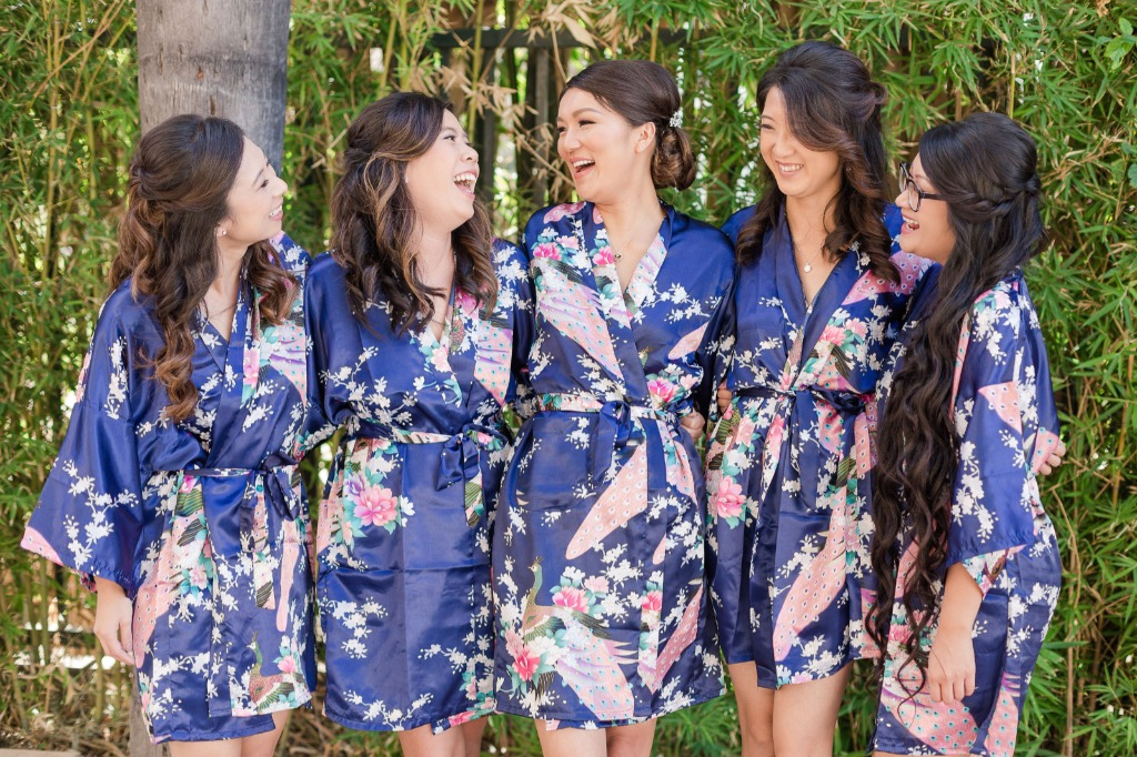 Don't be afraid to bring in a pop of color on your wedding day. We love these navy floral robes that our bride chose for herself and