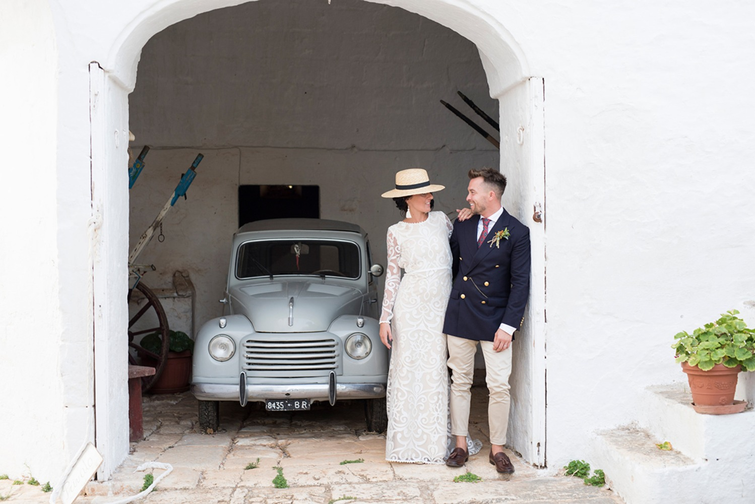 sweet wedding couple with vintage car