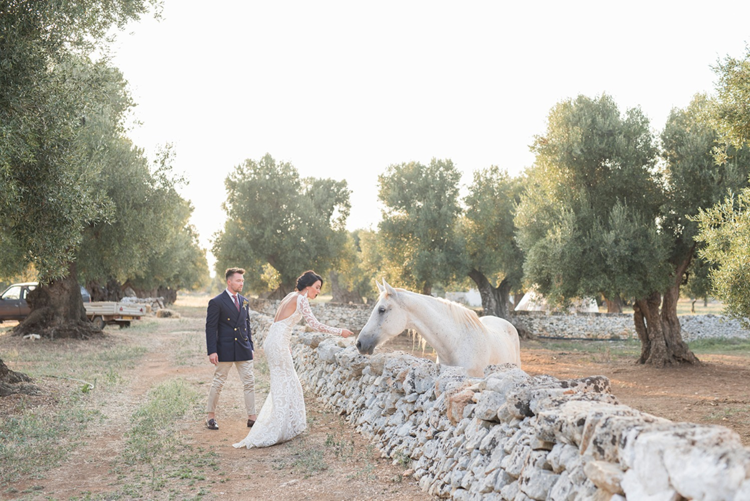 sweet candid wedding couple and horse