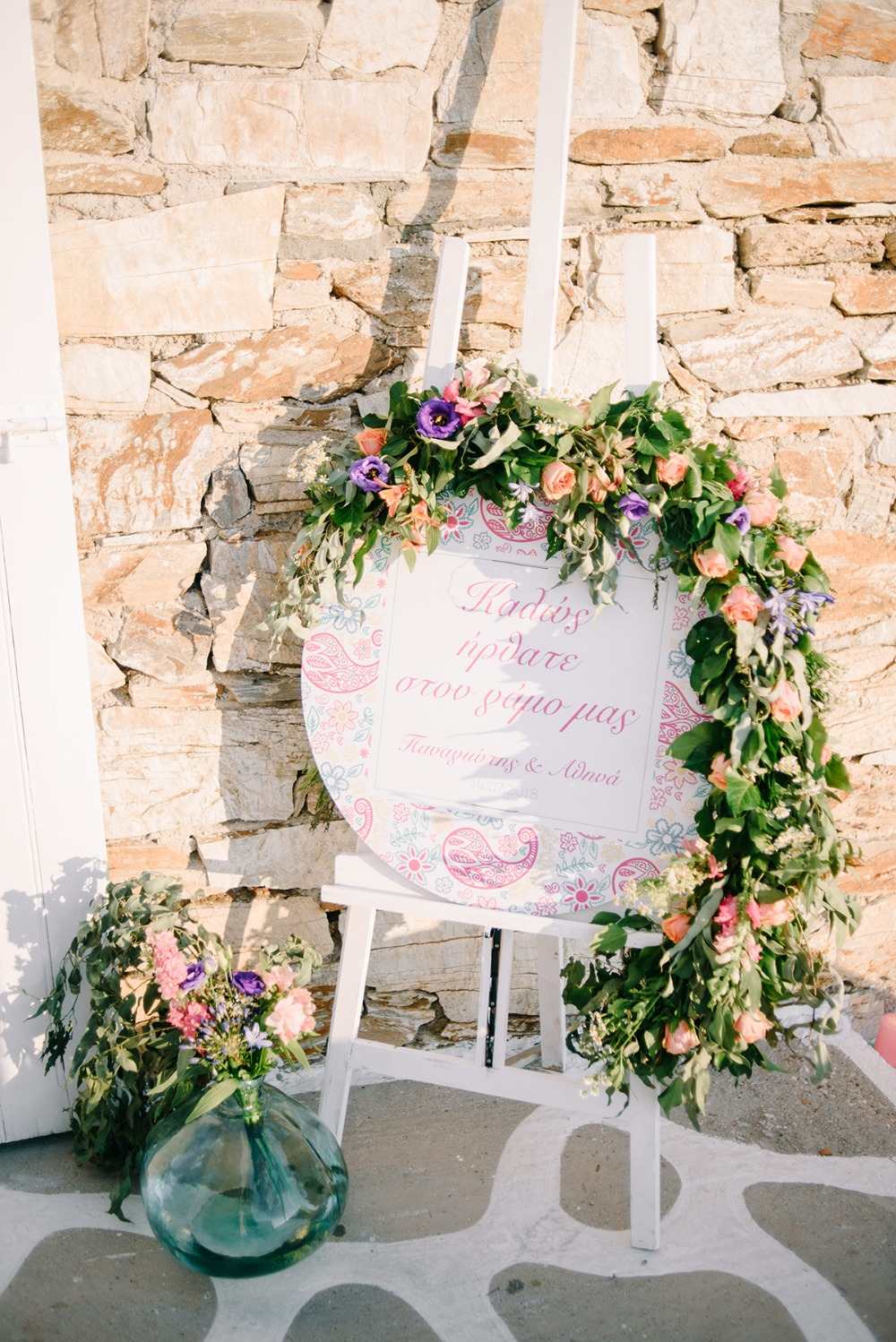 wedding sign with floral garland