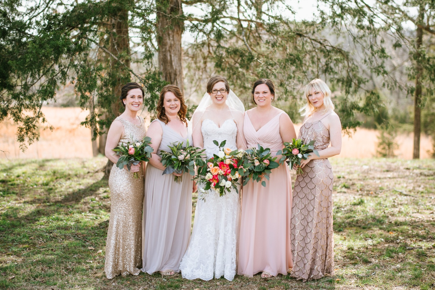 mismatched bridesmaids dressing in blush and gold