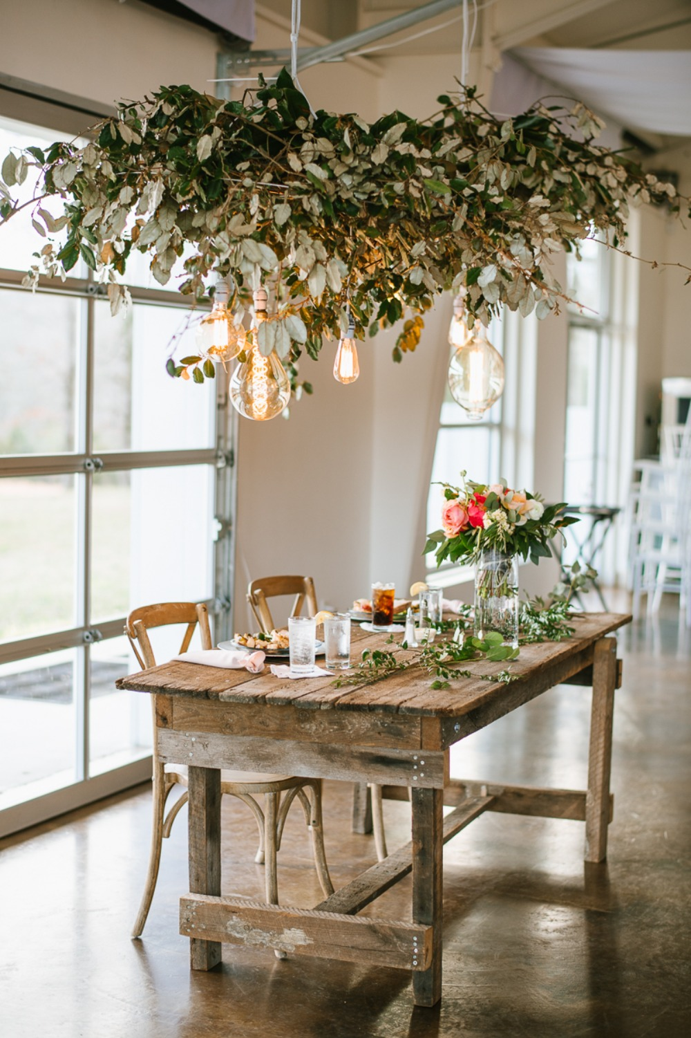 rustic sweetheart table with cascading greenery chandelier