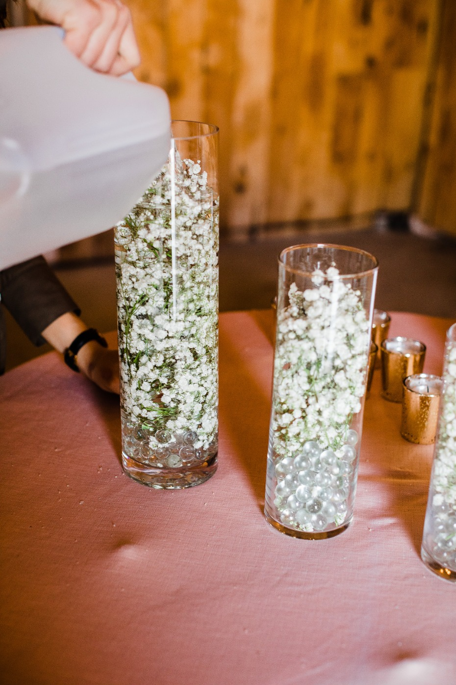DIY Wedding Reception Centerpiece Pouring in Water to Float Flowers