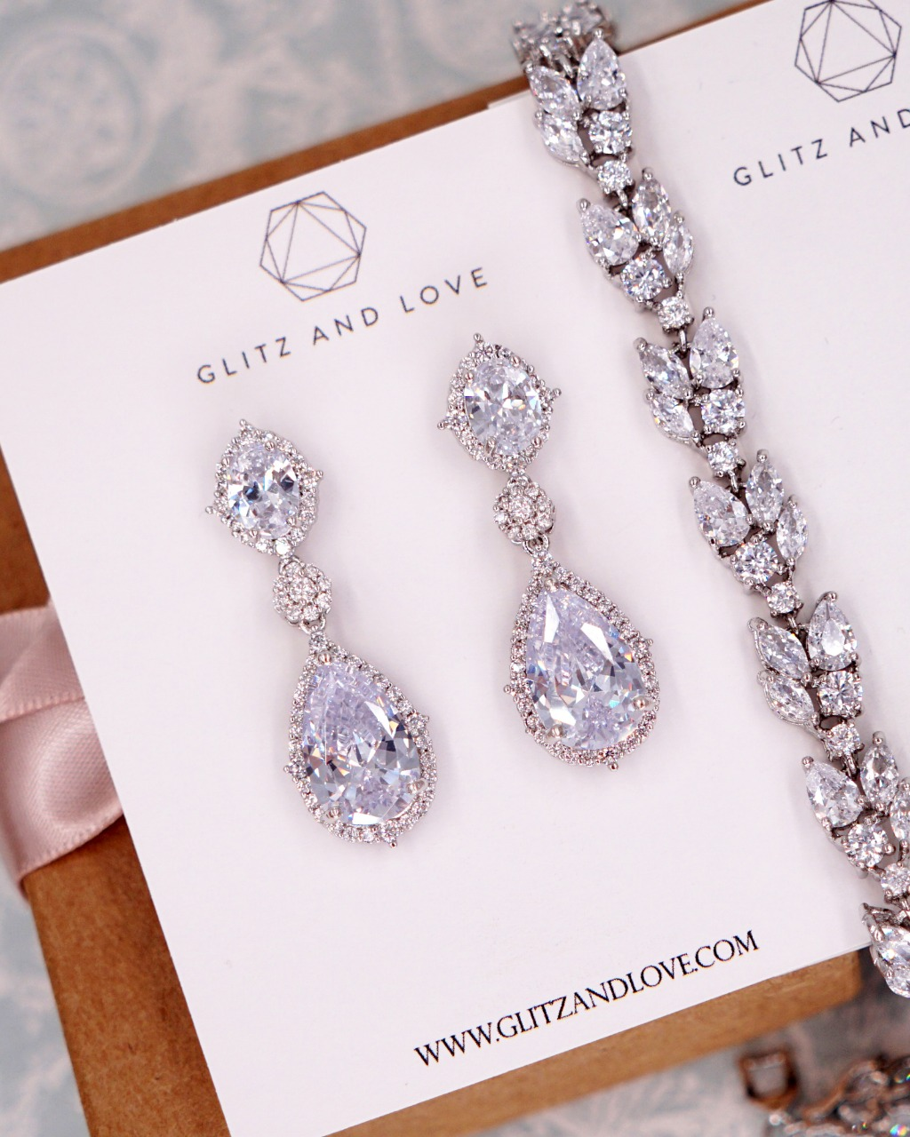 Silver Cubic Zirconia Earrings & Bracelet - Welcome to Glitz & Love where you will find a collection of exquisite and intricately