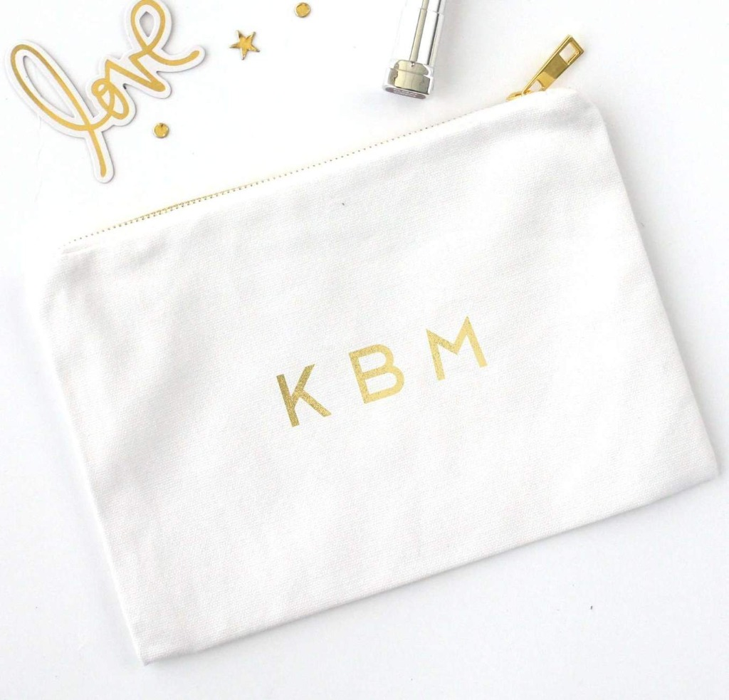 We love helping come up with the perfect bridesmaid gift, and this Foil Printed Cosmetic Bag with Monogram will awe any of your bridesmaids