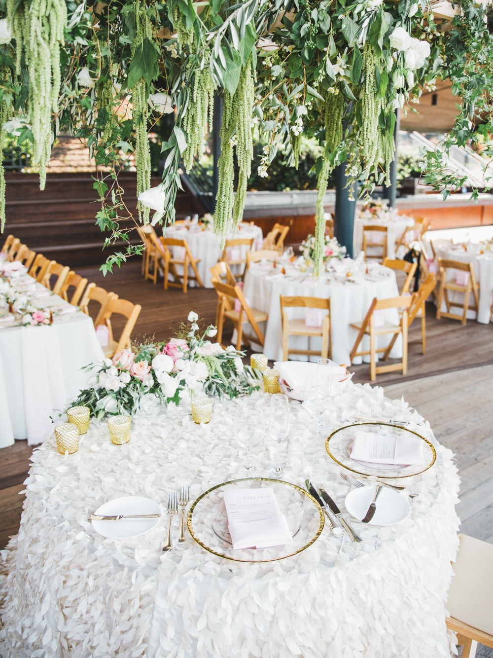 sweetheart table with cascading greenery chandelier