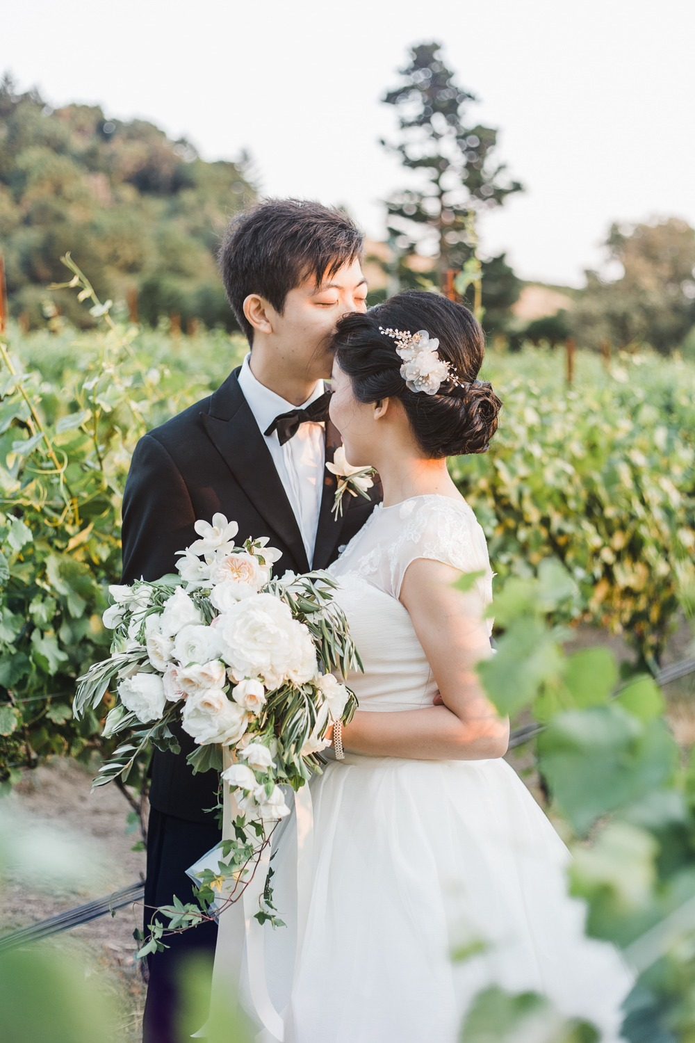 sweet wedding couple in a vineyard