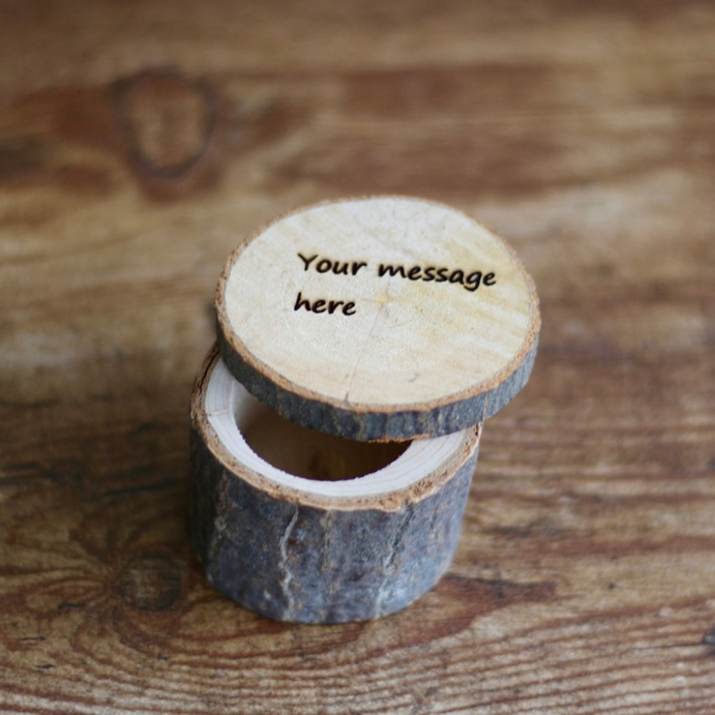 Rustic wooden log ring box. Customize this tree bark ring box with your own personal message on top of the lid.