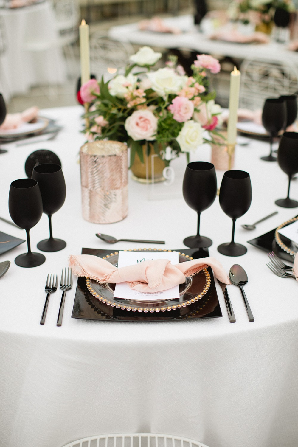 black and pink wedding place setting