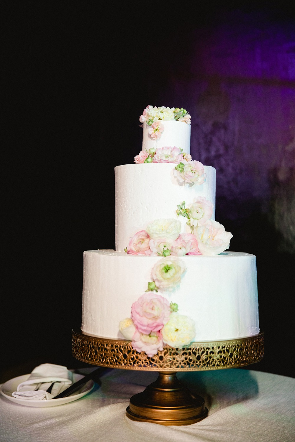 flower accented white wedding cake