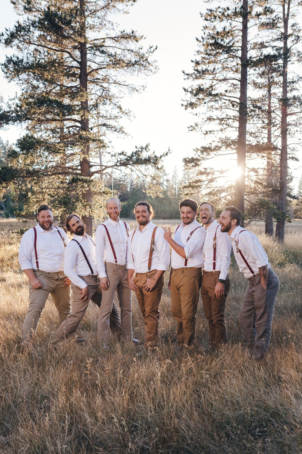 groom and his men in tan jeans and suspenders