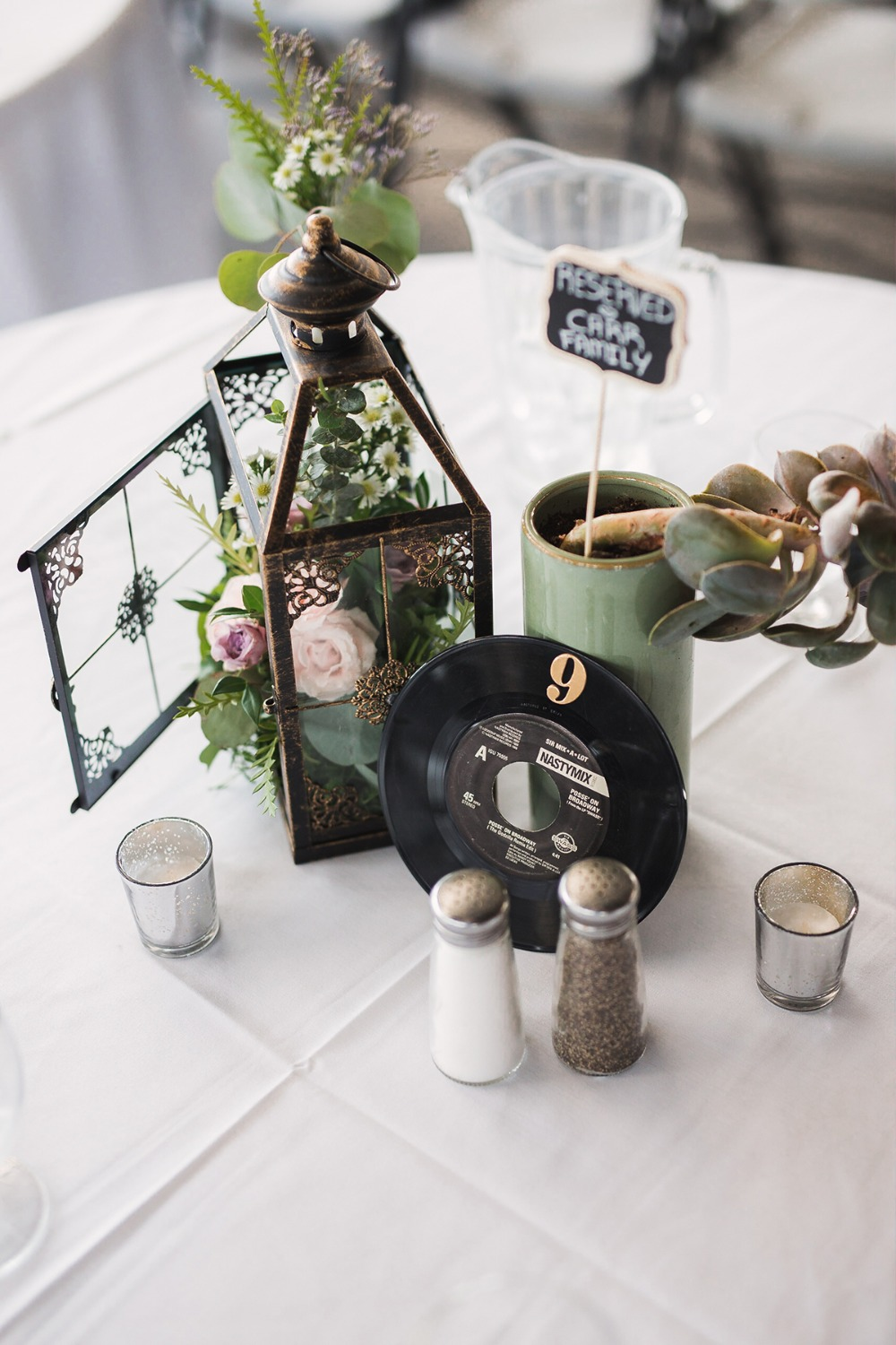 flower lantern and record wedding centerpiece