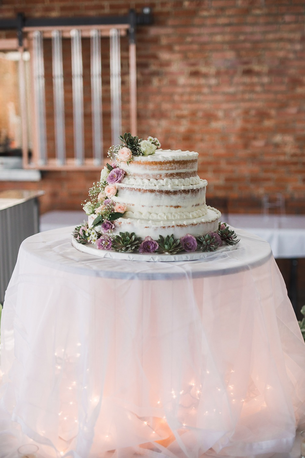 flower and succulent wedding cake