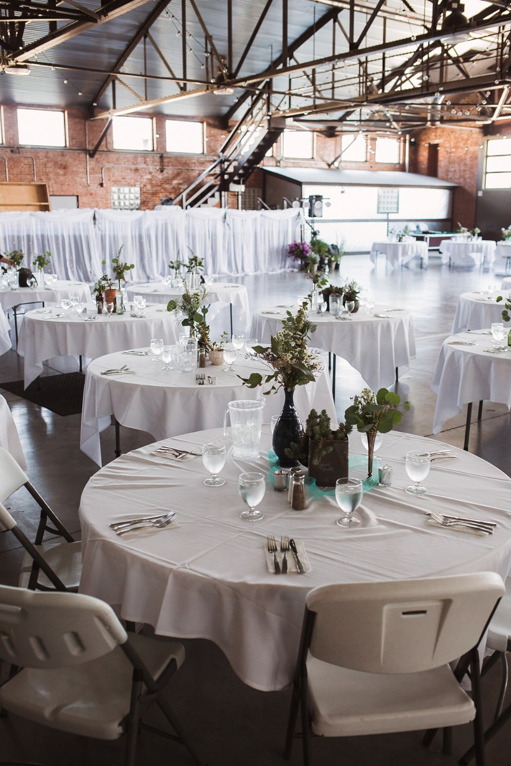 wedding reception in an airplane hanger