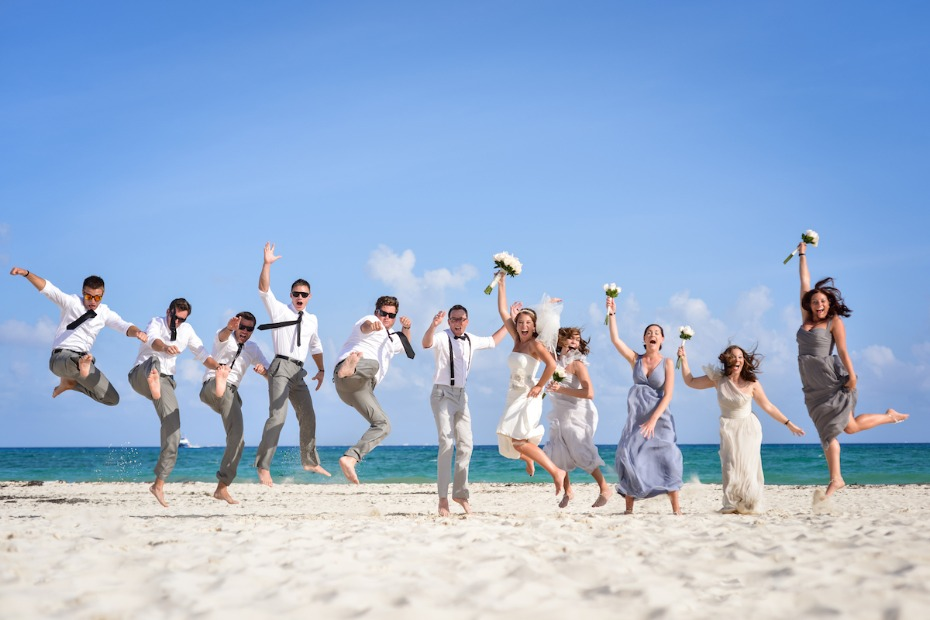 Palace Resorts destination wedding bridal party jumping on the beach