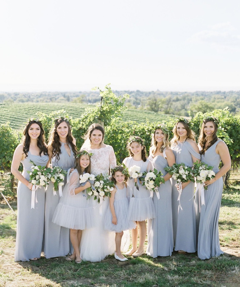 Bridal party in periwinkle over a field