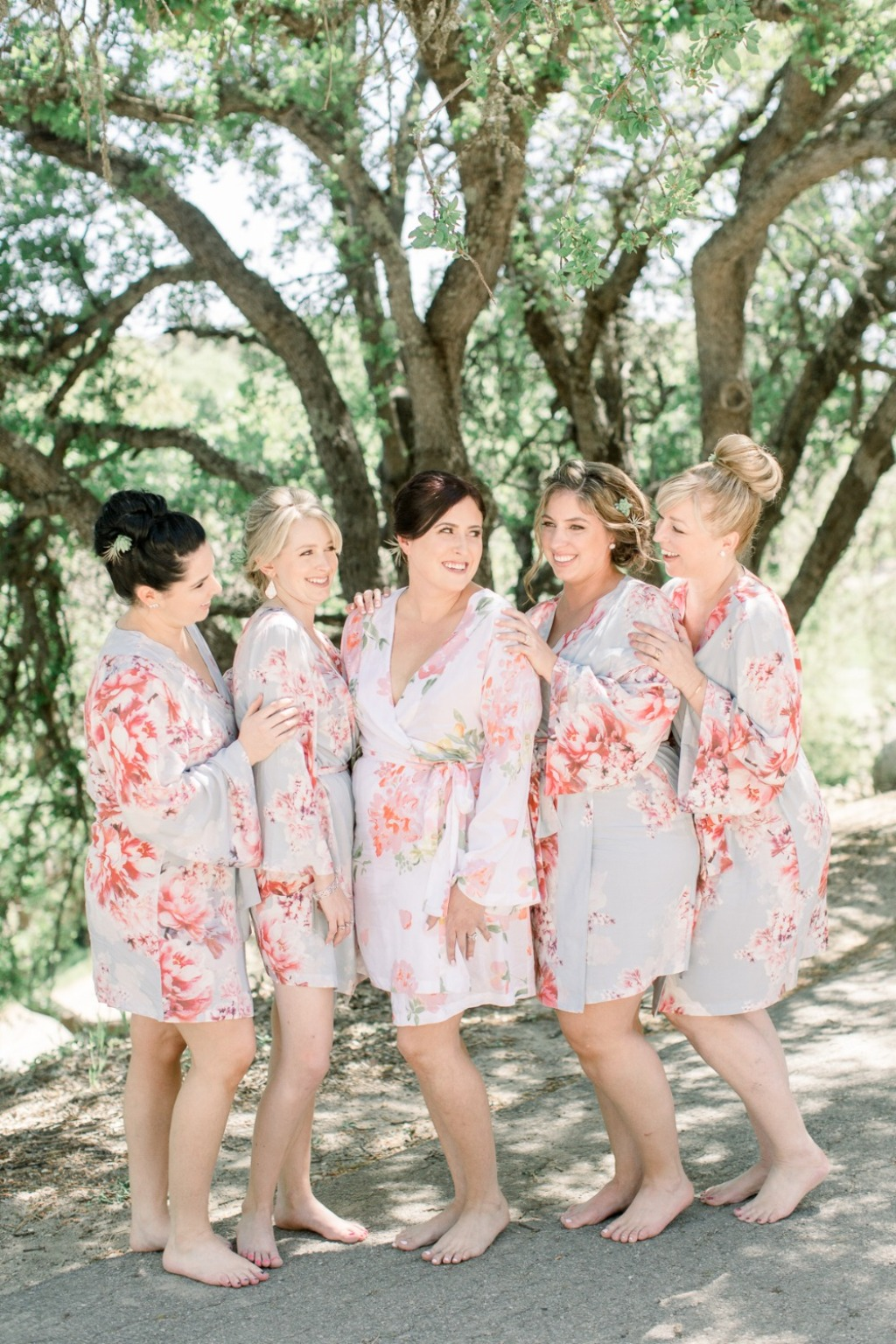 Bridesmaids in Oceane (blue) and the Bride is in Spell <3 Love these PPS bridesmaid robes.