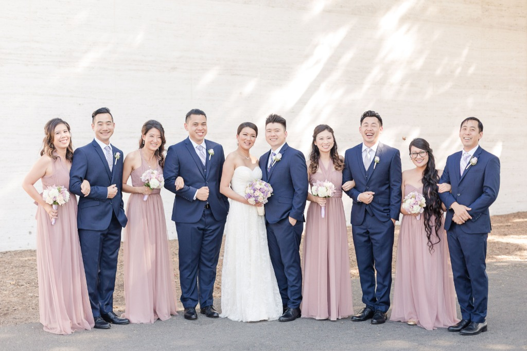 How picture perfect is this bridal party with their complementing colors? Our couple went with dusty rose dresses for the bridal party