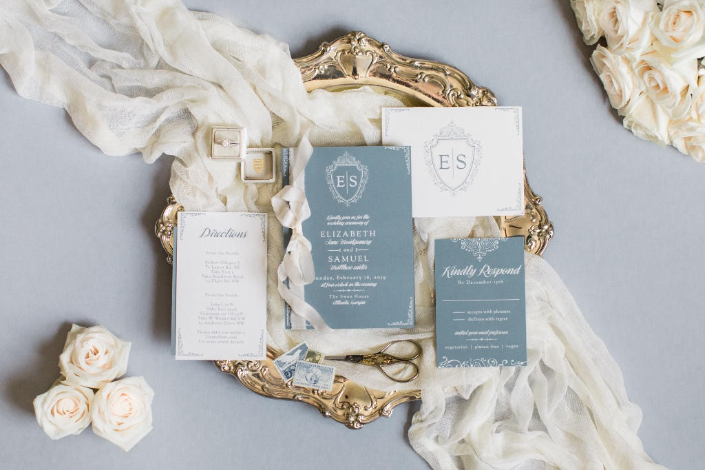 A luxurious badge containing your initials tops the Scrolling Monogram Wedding Invitations.
