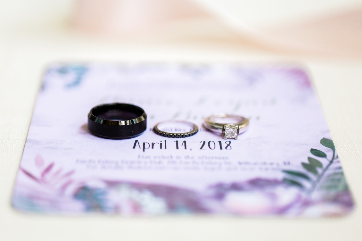 purple wedding invite and wedding rings