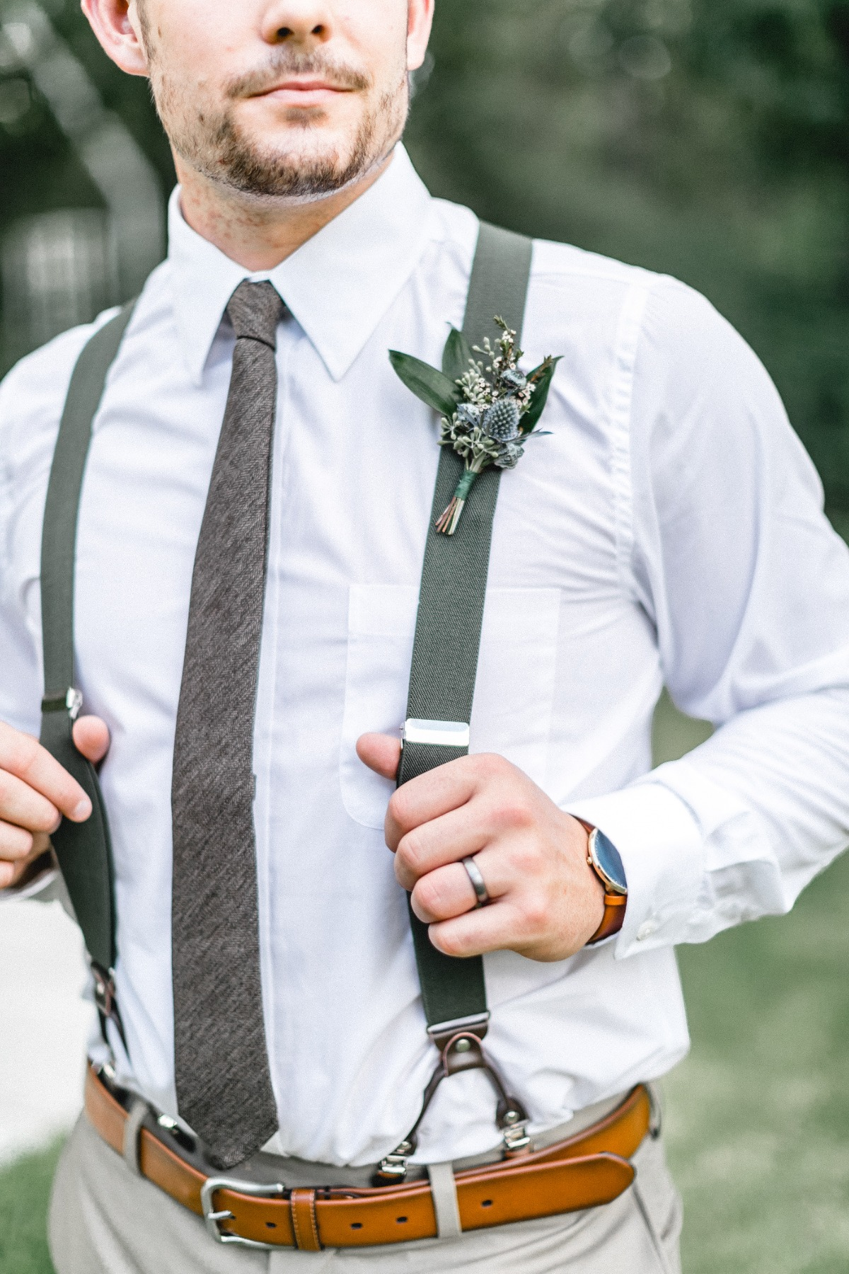 groom in suspenders