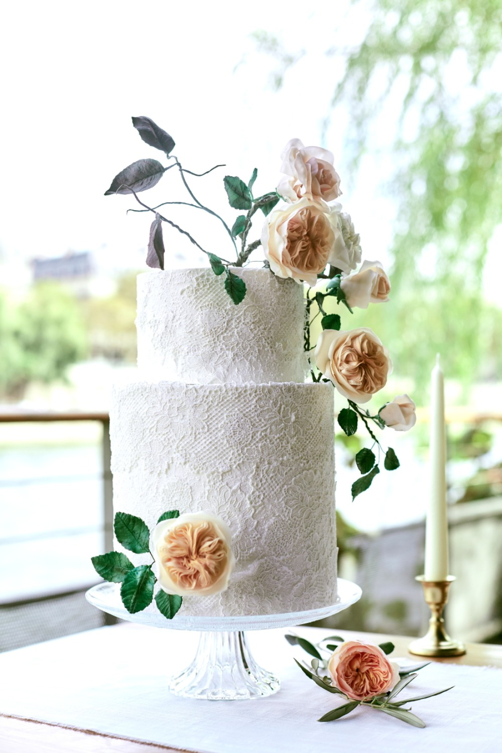 Lace wedding cake with florals