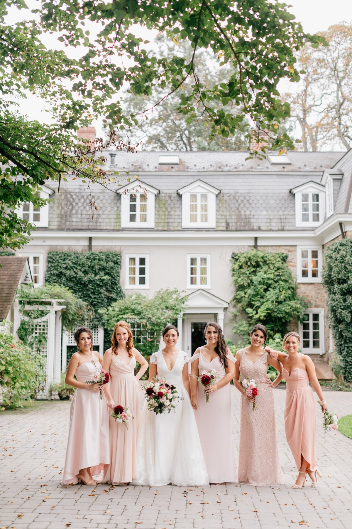 Mismatched blush rose bridesmaid dresses