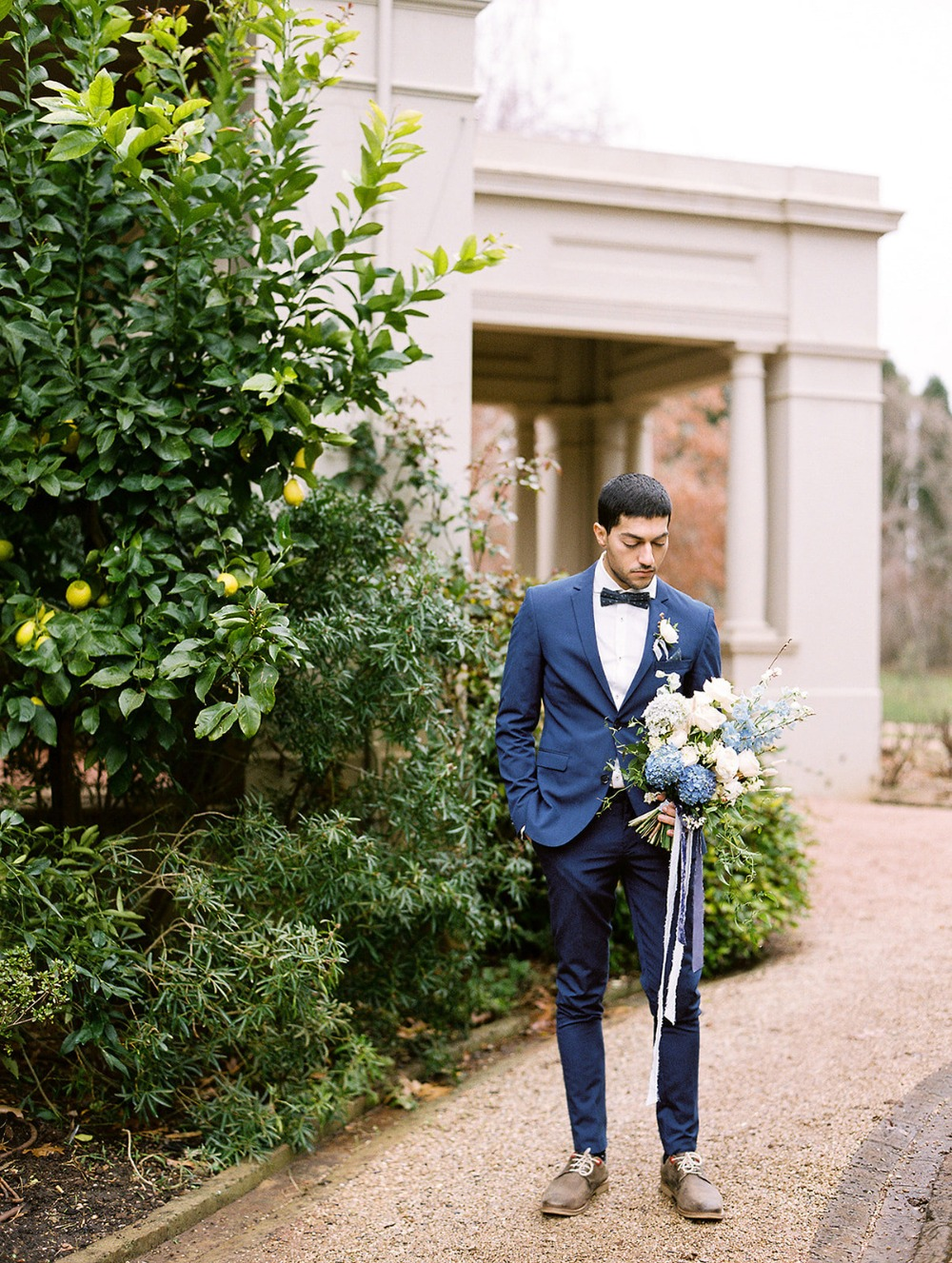 groom in dark blue suit