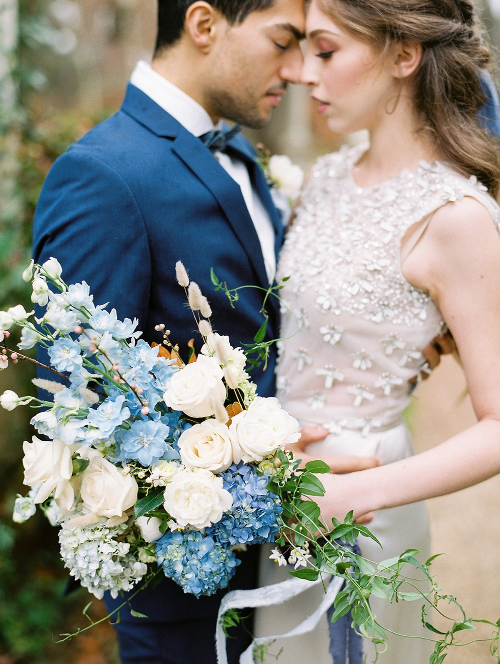 blue and white wedding couple