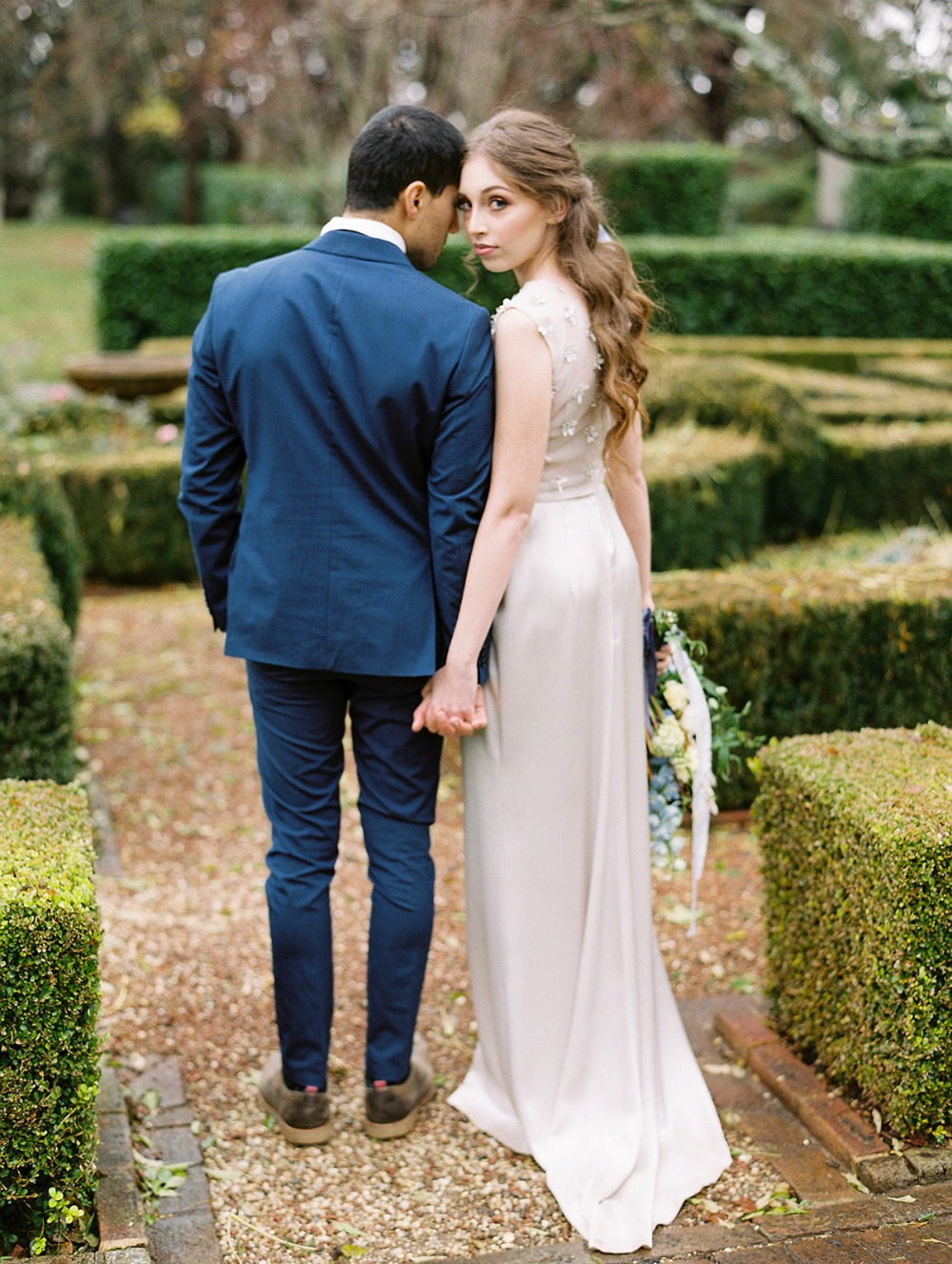 wedding couple in garden maze