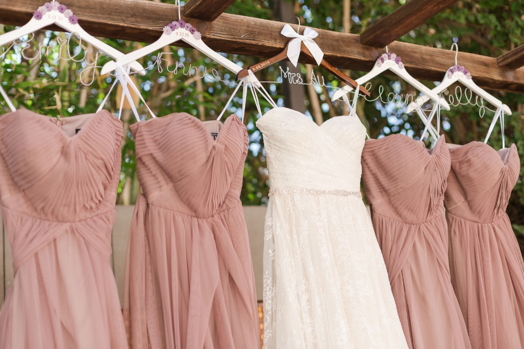 Our bride had custom dress hangers made for her bridal party, and they made for beautiful detailed shots. How perfect do their dresses