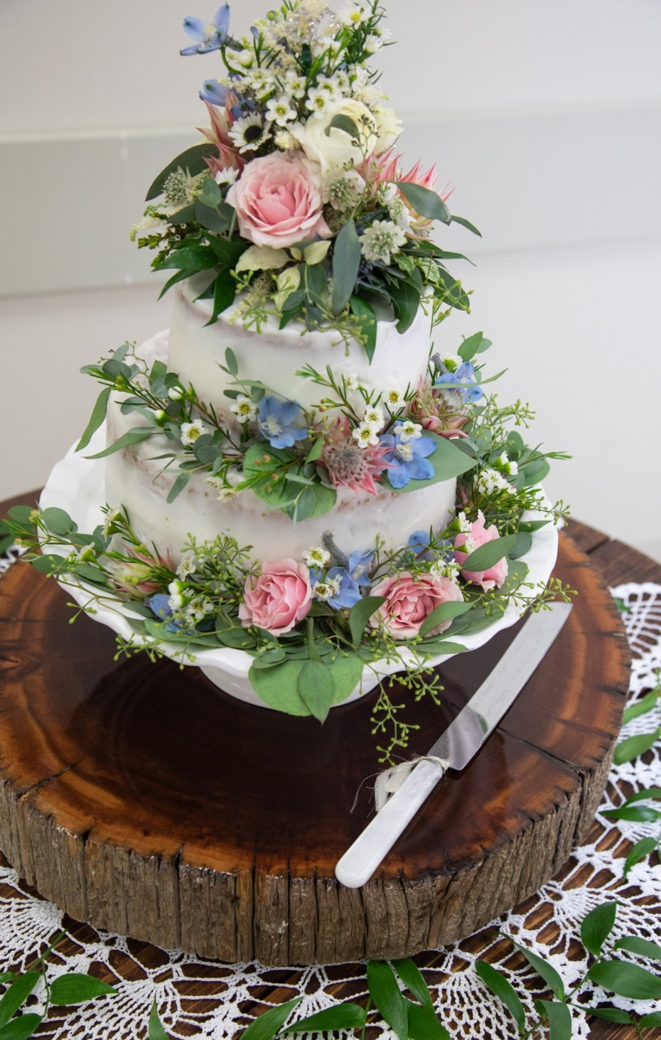 pink and blue floral topped wedding cake