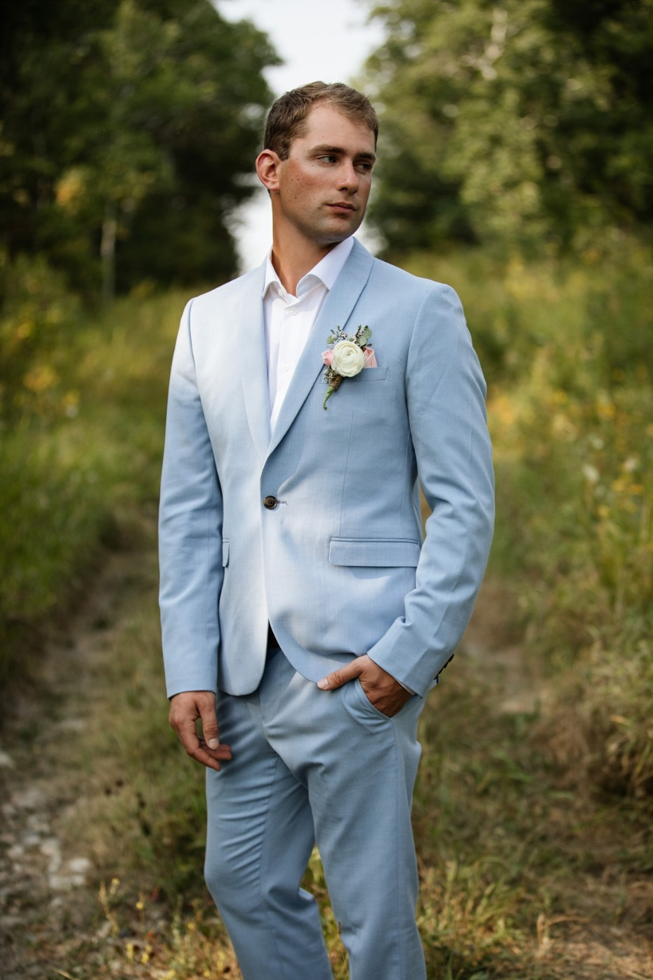 groom in soft blue suit