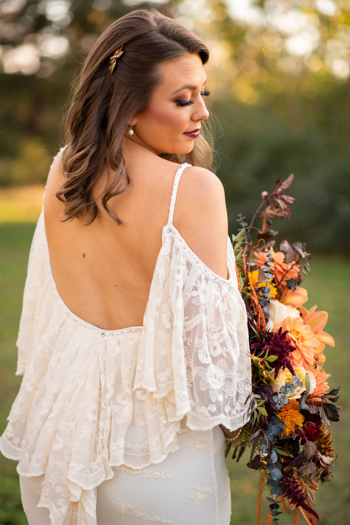 Lace boho wedding dress from Miss Madison Couture Boutique