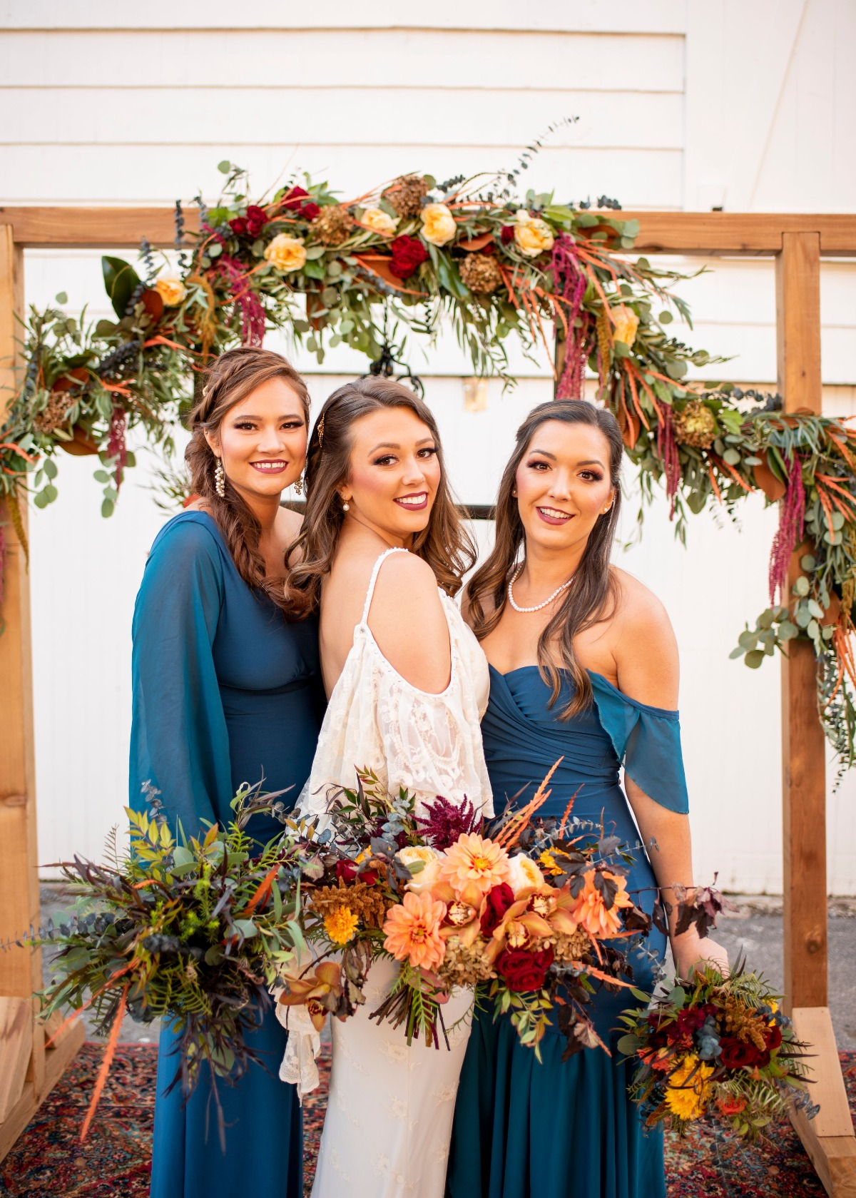 Fall wedding with blue bridesmaid dresses