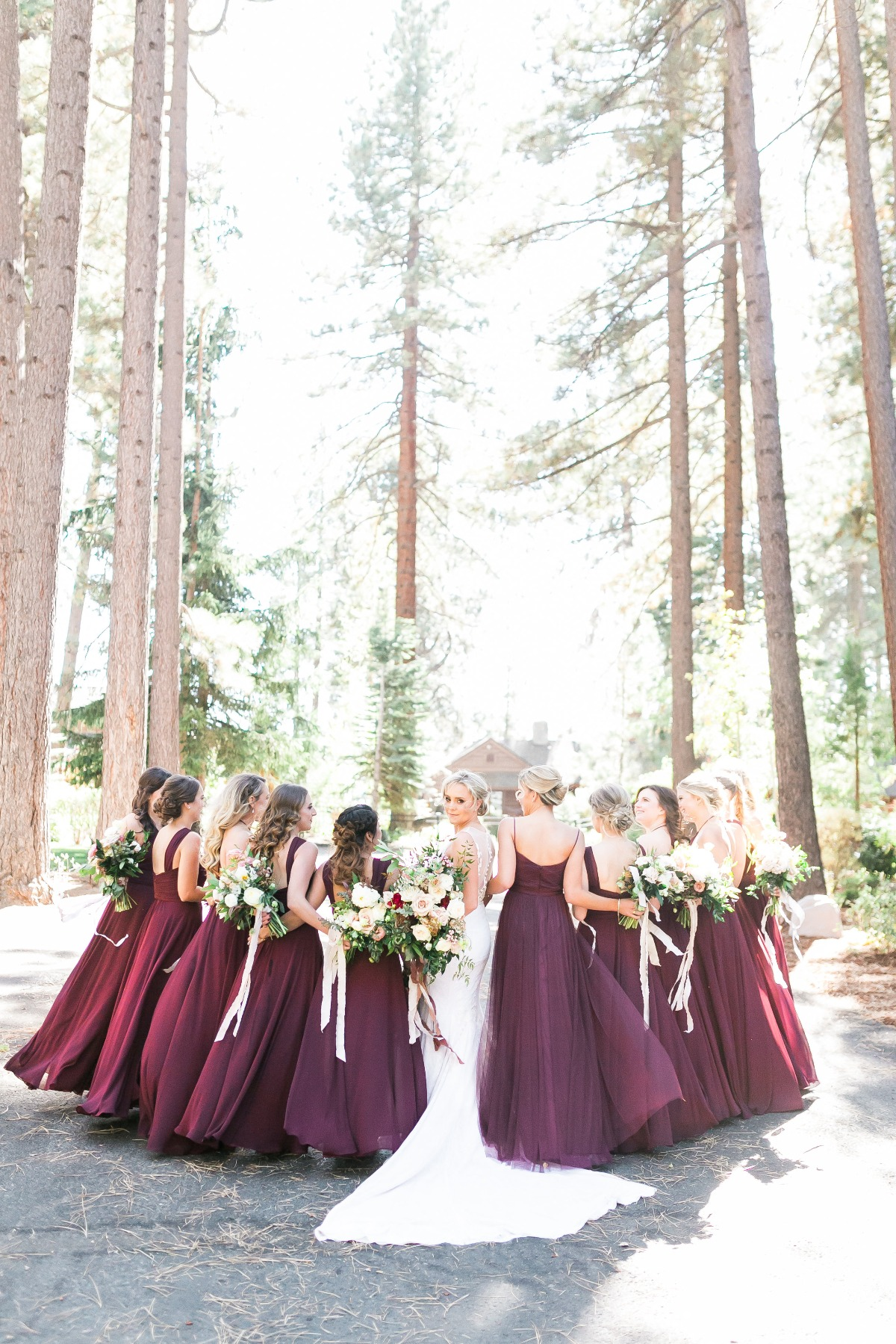 bridesmaids in deep plum dresses