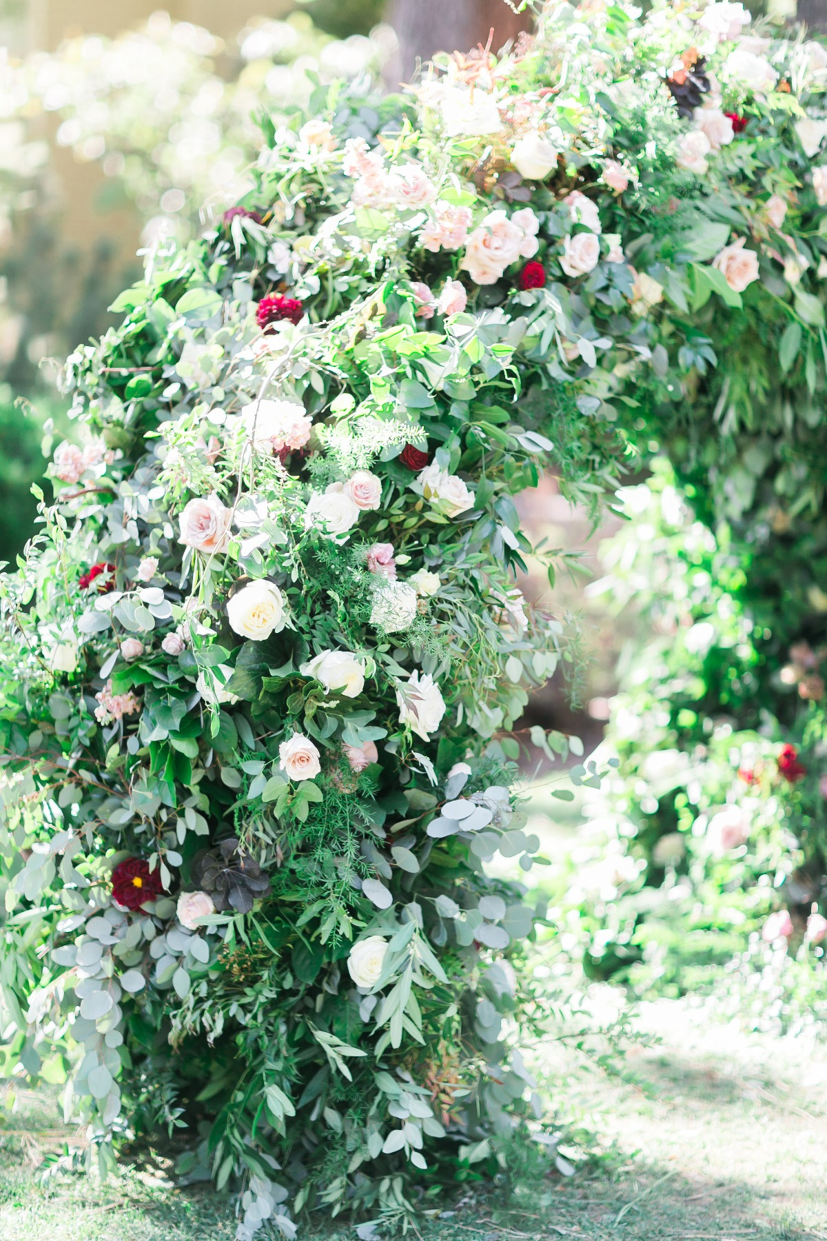 over grown floral wedding arch