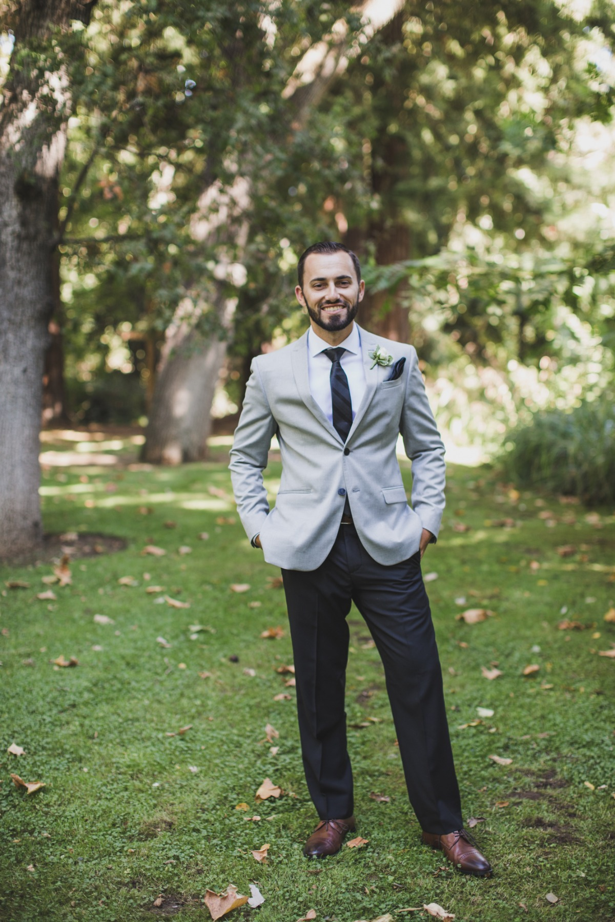 groom in gray jacket and black pants