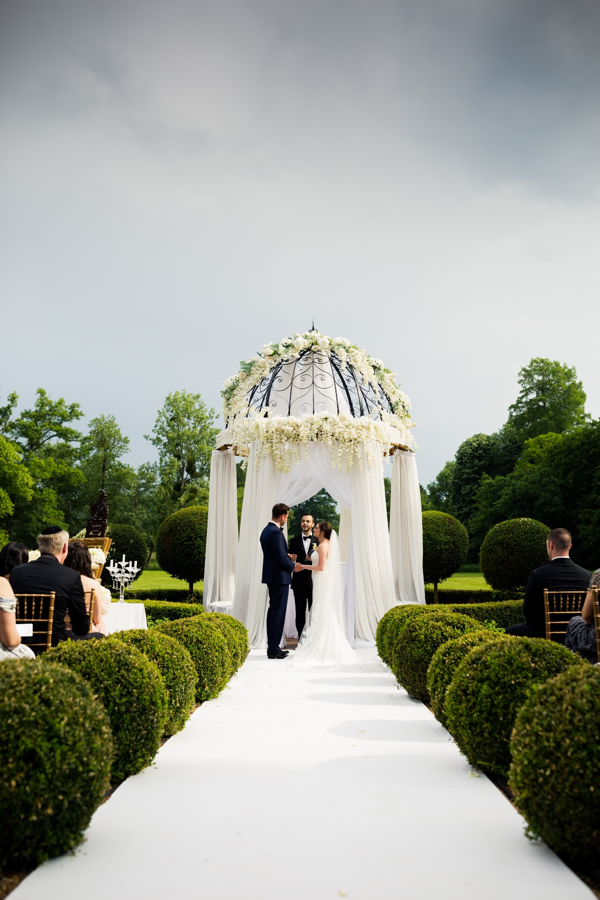 outdoor wedding ceremony in a manicured french garden