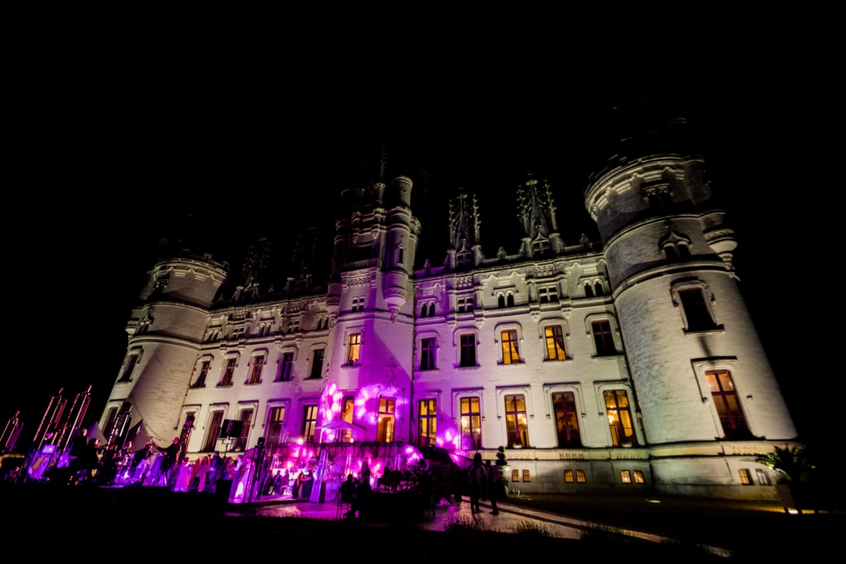 castle wedding with dramatic lighting