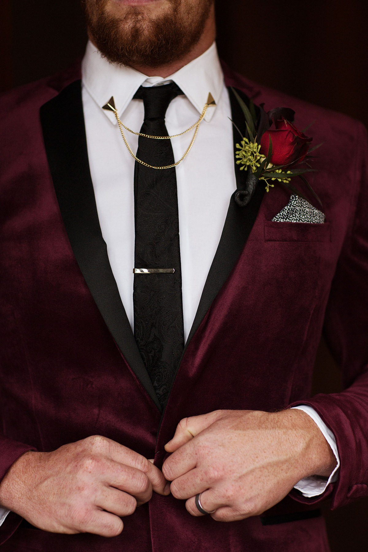 glammed up groom in burgundy velvet jacket