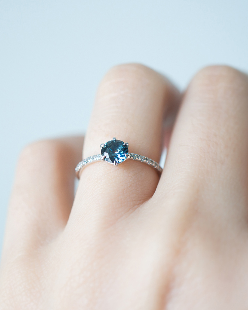 The sparkling deep blue Montana Sapphire gemstone in this ring was lovingly handcut in America by our favorite Husband and Wife gem