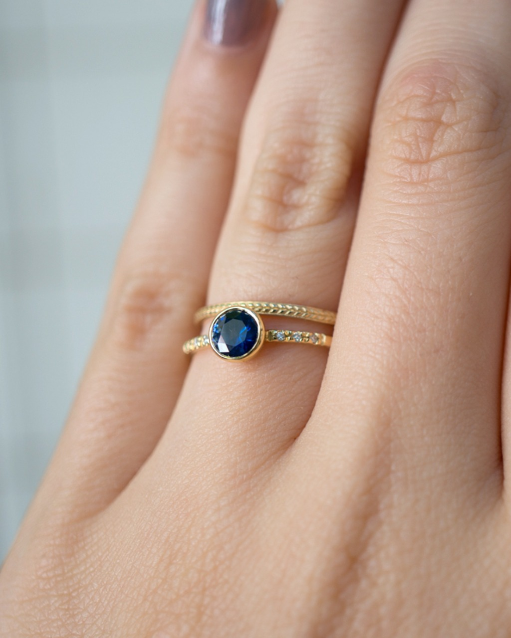 This Montana Sapphire has a beautiful saturated deep blue color with lighter toned sparkles. Set in our Maille bezel solitaire, the
