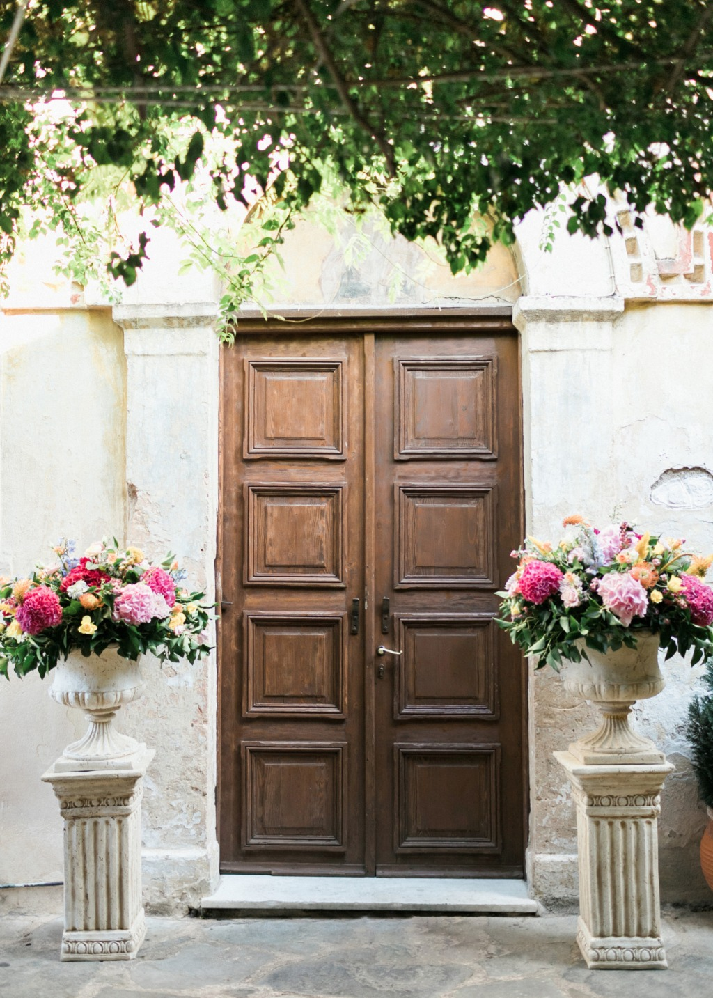 That pillars with colorful flowers looks great to this Byzantine church door! .